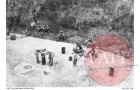 Australian POWs eating rice outside No.11 Mount Pleasant drive